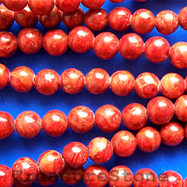 Bead, sponge coral (dyed), red, 6mm round. 16-inch strand.